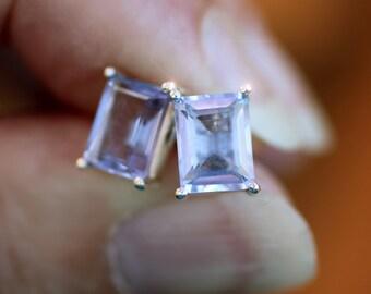 Artic Ice - Beautiful Faceted Emerald Cut Genuine Blue Topaz Sterling Silver Stud Earrings