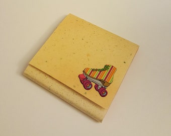 Yellow Speckled Sticky Notes Pad with Multi-Colored Striped Roller Skate