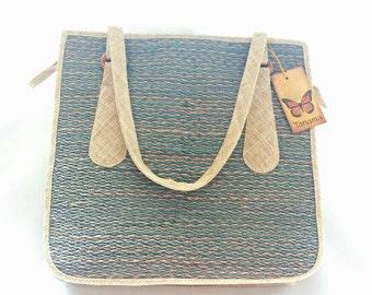Handmade raffia and natural fibers in blue and natural zip top tote bag
