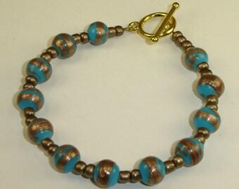 Turquoise and Bronze Swirl Bracelet