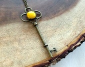 Large Yellow and Bronze Key Charm Necklace