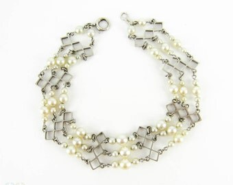 Vintage Cultured Pearl Bracelet, Graduated Triple Row Design in 9 Carat White Gold. Circa 1940s.