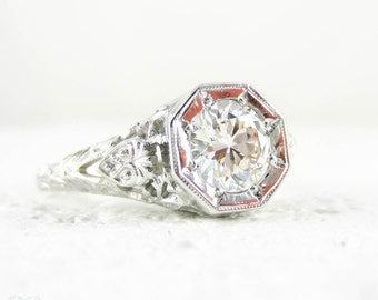 Filigree Diamond Engagement Ring, 0.77 ctw Old Cut Diamond in Floral Style Filigree 18ct White Gold Setting by Jabel, Circa 1920s.