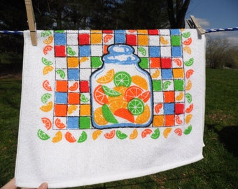 Cannon vintage kitchen towel hand towel or drying towel in orange green blue and black jars filled with colorful slices in green and oranges