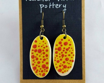 Red polka dot and yellow painted earrings