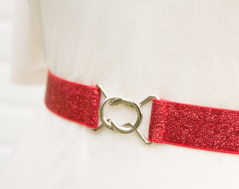 Womens skinny red glitter elastic cinch belt with choice of clasp colour