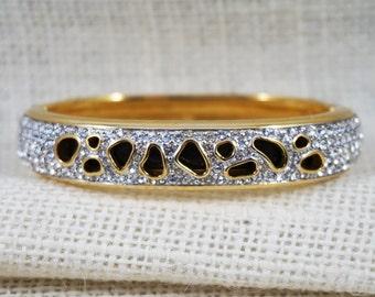 Signed Swarovski Retired Modernist Gold Tone, Enamel and Crystal Cut Out Bangle Bracelet