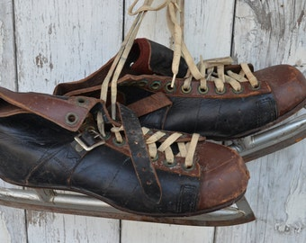 Pair of vintage 1930s 40s  Leather ice skates Brown Black Christmas decor star