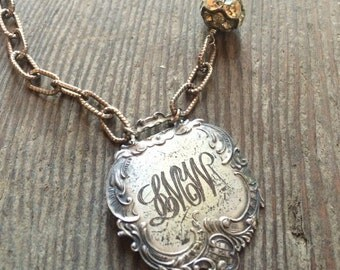 Antique one of a kind assembled repousse monogrammed luggage tag necklace