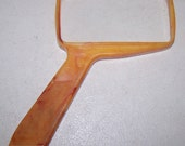 Bausch and Lomb Handheld Optical Magnifying Glass In a Butterscotch Color Bakelite Case
