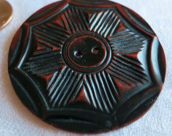 """Large 1.75"""" vintage plastic wafer celluloid button. 2 hole, dark Mahogany col, carved design in hexagon shape. Flat back. PFM12.10-13.3-5.5."""