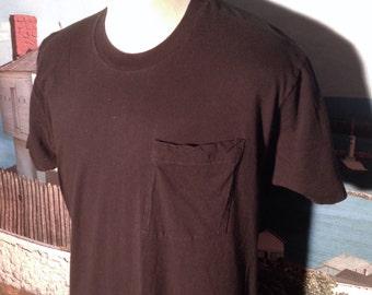 1980's blank pocket t-shirt, fits like a large