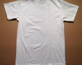 1980's blank white t-shirt, never washed or worn, fits like a small