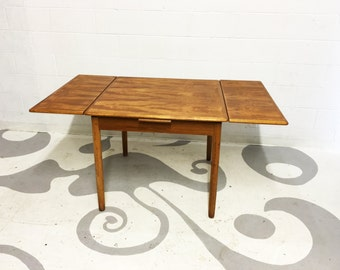 FREE SHIPPING mid century modern dining table in teak  in  good original condition  with two draw leaves made in denmark