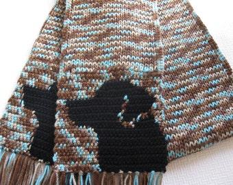 Black Labrador Retriever Scarf. Speckled, knit scarf with black lab dogs