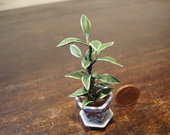Miniature dollhouse vase with plant
