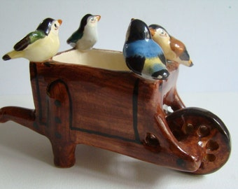 Wheelbarrow in earthenware with its four little birds, made in Vallauris, signed Maunier
