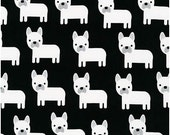 White Puppies on Jet Black from Robert Kaufman's Urban Zoologie Collection by Ann Kelle