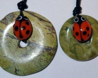 Gemstone Jasper Donut Pendant with Glass Ladybug on Leather. One Pendant your choice