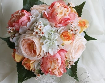 Peachy - Wedding bouquet, white hydreangea, peach and light orange roses, peach peonies and very pale peach Geraldton wax.