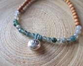 Delicate bell chime bracelet with om bell, moss agate, and sandalwood mala stretch bracelet