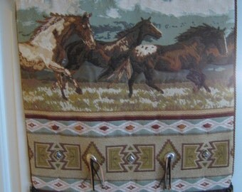 Table runner with horses design.