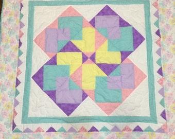 Geometric baby girl quilt