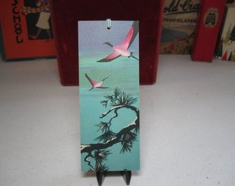 Colorful unused art deco 1920's-30's bridge tally card pink and black birds flying over snow covered tree branches