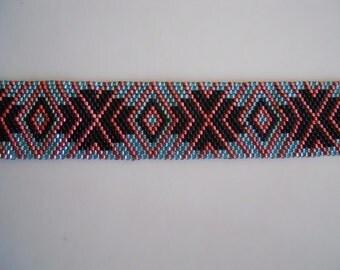 Pink, blue and black bracelet