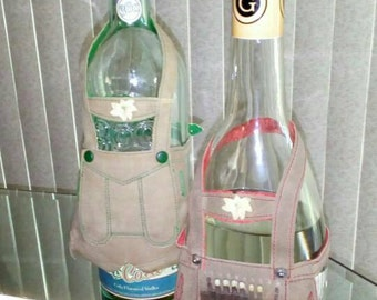Pair of vintage West German Lederhosen Liquor Wine Bottle Wraps with wood matchbooks