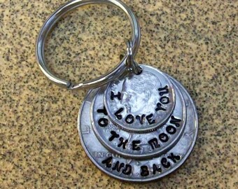 I love you to the moon and back keychain key chain keyring made of layered US dime quarter and half dollar coins.