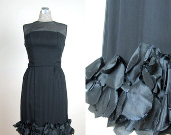 25% Off Summer Sale.... Vintage Early 60s 1960s Black Cocktail Dress with Ruffled Petal Hem and Illusion Neckline size 8 M