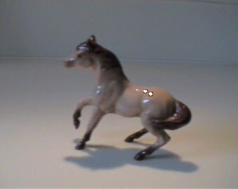 Vintage miniature Hagen Renaker Buckskin mare prancing horse
