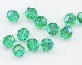 Twelve Swarovski crystals in the non-standard color light emerald AB - Art. 5000 - 8 mm