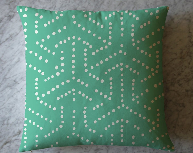 Pillow with Dots on Green Background. April 7, 2016