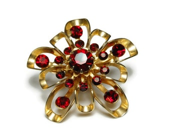 1940s Coro brooch, 1940s early 1950s gold open work petals on this floral brooch with ruby rhinestone faceted center and embellishments