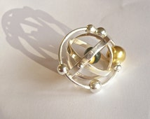 sterling silver solar system armillary kinetic pendant