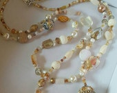 Queen of Khaki- multi strand, long, beaded necklace with crystals, glass pearls, freshwater pearls, cats eye, artisan statement beads.