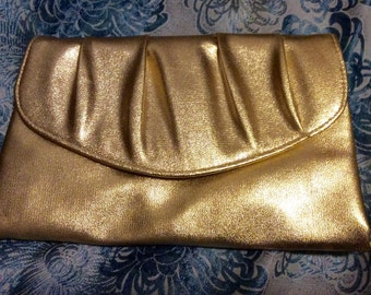 Bad girl 50's  Fifties gold clutch purse never used