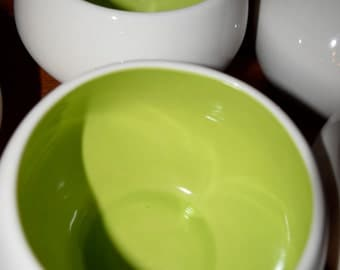 Two fab vintage heavy white bowls with rich green interior