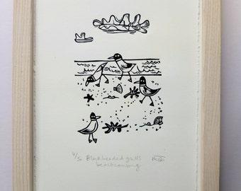 Black headed gulls beach combing - lino cut print