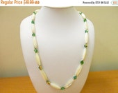 ON SALE NAPIER Mother of Pearl and Green Aurora Borealis Beaded Necklace Item K # 1802