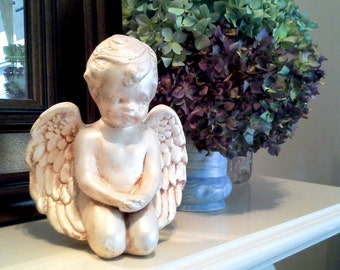 Sitting Angel or Cherub, aged with paint and wax, shimmery golden brown over off white cast plaster