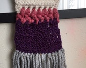 Handmade purple , eggshell and pink crochet wall hanging on a golden painted wood post.