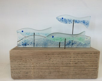 Recycled glass shoal of fish...