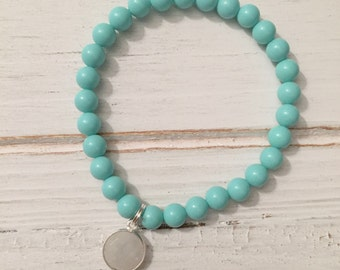 Turquoise resin beaded bracelet with sterling silver moonstone bezel charm