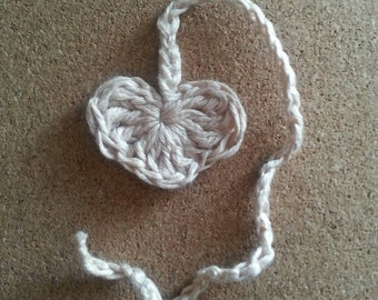 Heart shaped umbilical cord tie. All natural linen fibers and less dyes.