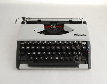Cursive Typewriter, Olympia SF Deluxe, Script Font