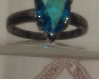 Black gold plated and neon blue CZ ring (size 6)