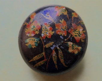 Painted folk button, antique.  Hand painted wood, convex, floral with a black japanned base, the top has been lacquered.  c1900.